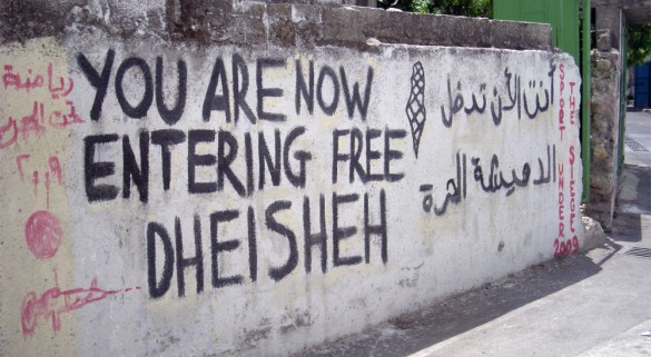 Activist graffiti emblazons the walls of Dheisheh camp