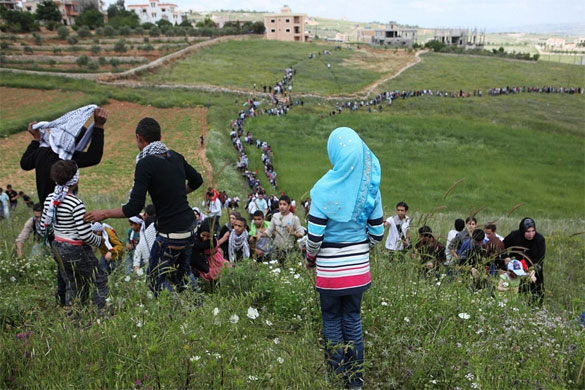 Palestinians mass on the Israeli border in Maroun al-Ras, Lebanon