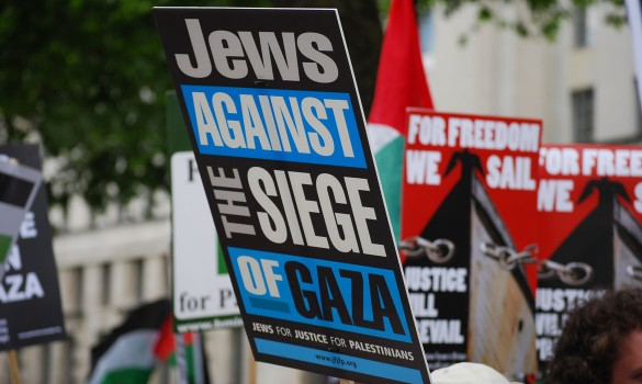 Placards in support of the flotilla at demonstration in London, May 2011